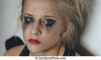 Closeup of young teenage girl dancer crying after loss...