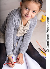 Adorable artistic little girl doing drawing