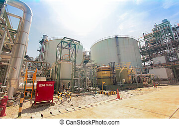 Industrial power plant, red hose house, big tank with light...