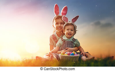 Kids with Easter eggs - Two cute little children wearing...