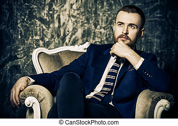 classy mature man - Respectable handsome man sitting in...