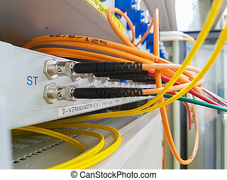 Closeup of fiber optic cable plugged into switch.