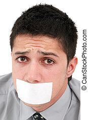 Censored speech - A young businessman with a band on his...