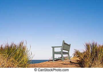 A bench on shore of the Baltic Sea.