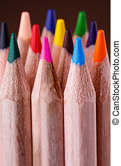 group of sharpened colorful pencils on brown background....