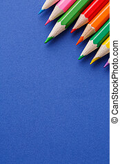 Colored pencils angle. Many different colored pencils on...