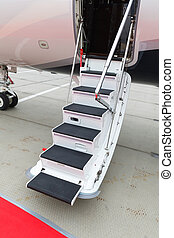 ladder in a private jet - white private jet and open ladder,...