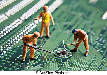 Building a better future - Worker figurines placed on a...