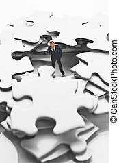 Business figurine on puzzle pieces - Business figurine on...