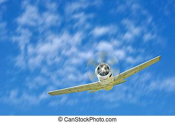 Retro warplane fly with blue sky