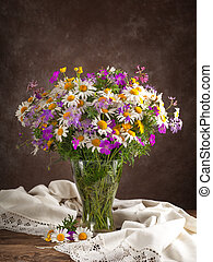 bouquet of wild flowers on the table in the interior