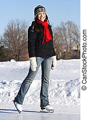 Ice Skating Woman - Ice skating girl. Young woman skating on...