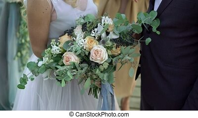 Bride and groom on wedding ceremony with bouquet - Bride and...