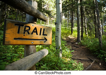 Trail Sign - Trail sign in the forest, pointing towards...