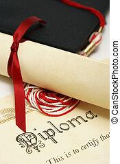 Students Success - A diploma and grad hat represent a high...
