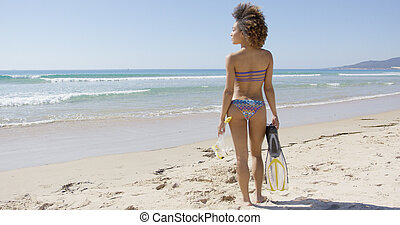 Female going to sea with flippers - Female wearing two-piece...