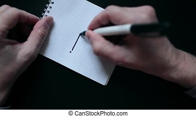 Drawing a Graph in notebook - person Hold marker in hand,...
