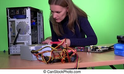 Skilled computer repairer woman upgrade desktop computer...