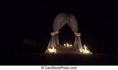 Wedding ceremony decoration with candles at night
