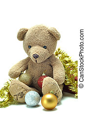 Cute teddy bear sitting and tied with gold ribbon X mas ball...