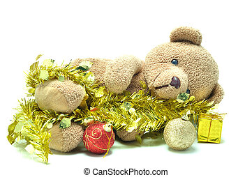 Cute teddy bear lying on white background and tied with gold...