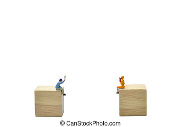 Selective focus, man and woman say hello on wooden cube,...