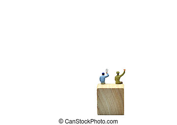 Selective focus, 2 men say hello action on wooden cube,...