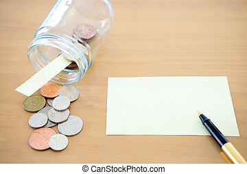 Money jar with U.S. currency represents savings, donations concepts.