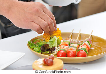 Food stylist setting up 3 barbecue sticks grilled lay on brown plate for take photo to use with food advertising.