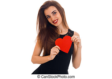 beautiful young girl in a black dress and red lipstick on lips holding a heart shaped card