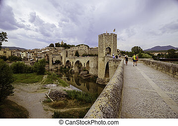 People on the bridge of Besalu