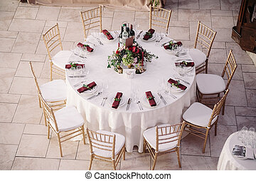 Interior of a wedding decorated table ready for guests, view...