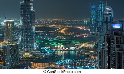 Aerial view of Dubai downtown Lake area night timelapse and...