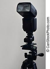 Speedlight gun with trigger set mounted on tripod - External...