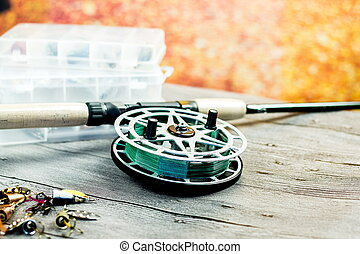 fishing spinning rod with reel on the wooden table