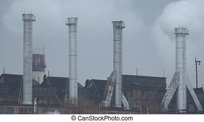 Smoke pipe factory - White smoke from the chimney of thermal...