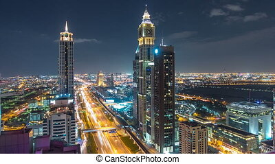 Scenic Dubai downtown architecture night timelapse. Top view...