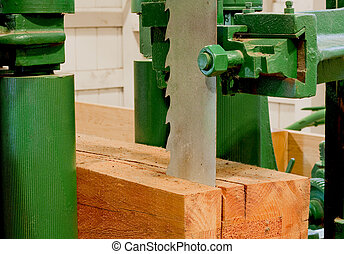 large bandsaw cutting a timber - large industrial bandsaw...