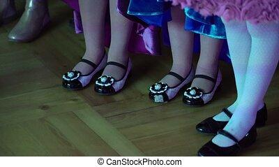Childrens girls staying indoors legs shot