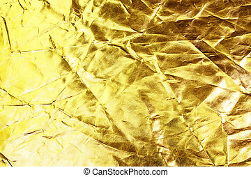 Gold background or texture and shadow. Gold fabric crease.