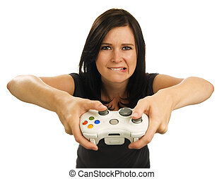 Girl bites lip as she holds video game controller - Girl...