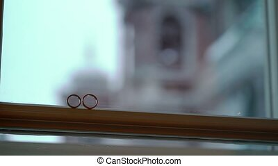 Two rings on a window - Two wedding rings on a window