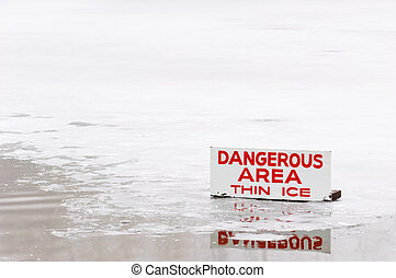 Dangerous area: Thin Ice - A pond covered in a thin layer of...