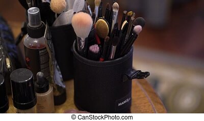 Professional makeup brushes in cup