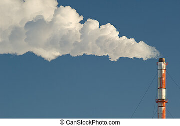 Industrial smokestack - Smoke billows from a smokestack...