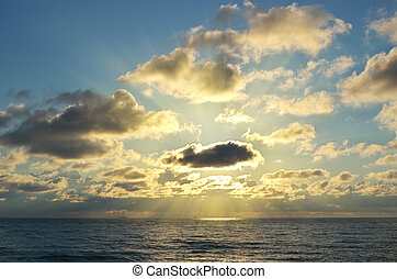 Sun and clouds on sea. - Sun behind the clouds on sea....