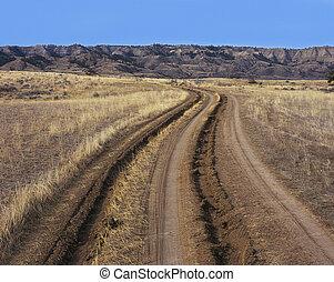 Ruts in dirt road - Deep tire ruts in dirt road.