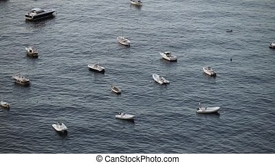 Boats in a sea at sunny day