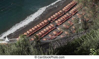 Italian beach in Positano at sunny day