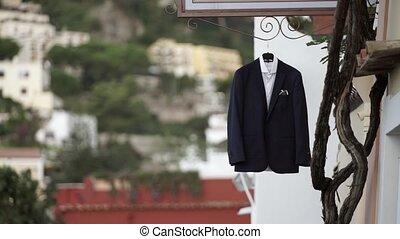Groom's suit in Italian street outdoors